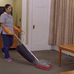 vacuuming a hotel room