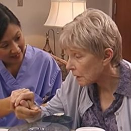assisting a woman with dementia